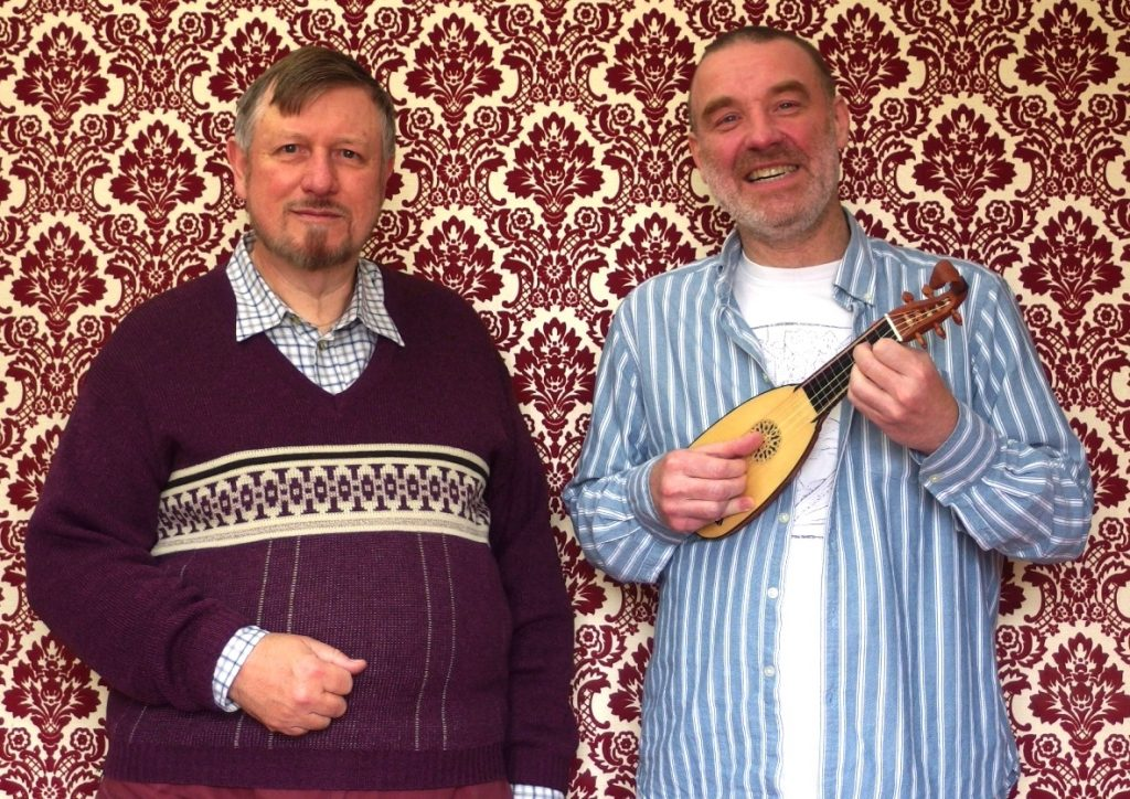 Mandore maker, Paul Baker, next to its happily playing owner, Ian Pittaway.