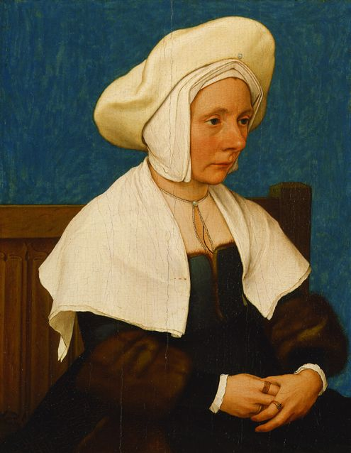 Portrait of a woman, c. 1532-35, by Han Holbein, wearing a pinned-on Holland linen shawl and cap under a woollen hat.